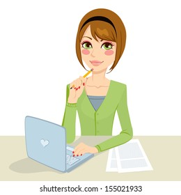 Beautiful pensive brunette office secretary woman typing on her computer and holding a pencil on her hand