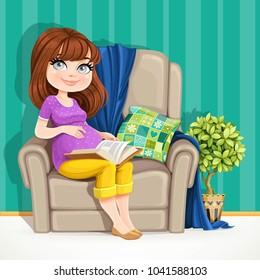 Beautiful pregnant woman sitting in comfortable armchair and reading a book