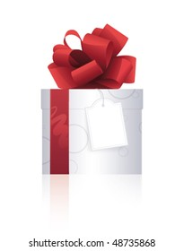Beautiful present with red ribbon and label on a white background