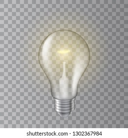 Beautiful realistic vector lit light bulb on transparent background.