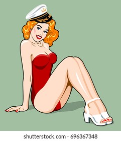 Beautiful red-haired girl in a red swimsuit and captain's cap. Pin Up Style