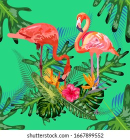 Beautiful seamless floral pattern background with pink flamingos, tropical flowers.