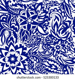 Beautiful seamless pattern of flowers and intertwined branches. Hand-drawn in doodle style. Vector illustration.
