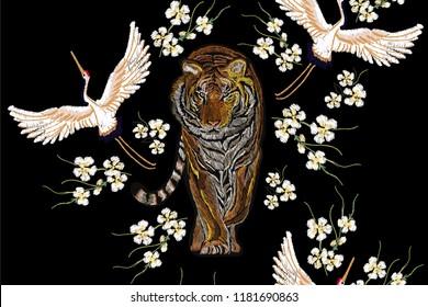 Beautiful seamless vector floral summer pattern background with tiger, tropical japanese flowers, crane birds, sakura cherry flowers. Perfect for wallpapers, web page backgrounds, surface textures