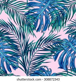 Beautiful seamless vector tropical floral pattern background with palm leaves, jungle plants
