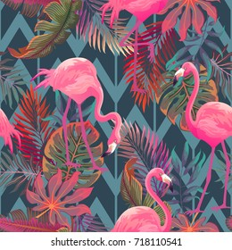 Beautiful seamless vector tropical pattern with pink flamingo and palm leaves on geometric background. Abstract summer texture