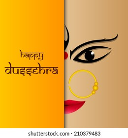 Beautiful smiling face of Goddess Durga on brown and yellow background with the stylish text for Dussehra festival celebrations.