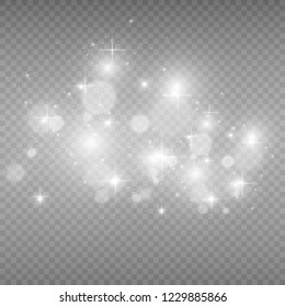 Beautiful sparks shine with special light.Christmas abstract pattern. A beautiful illustration for the postcard. The background for the image. Luminaries.White glowing light. Beautiful stars.
