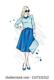 A beautiful, tall girl with long legs in a stylish skirt, glasses, blouse and in high heeled shoes. Fashionable look. Clothes and accessories. Vector illustration.