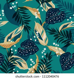 Beautiful tropical leaves. Seamless graphic design with palms leaves and flowers. Fashion,fabric and all prints on stylish green background