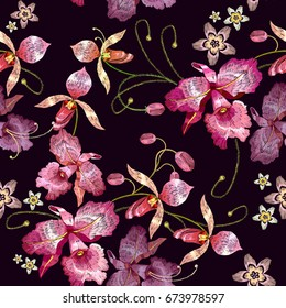 Beautiful tropical orchids paradise flower, classical embroidery template for clothes. Orchids embroidery seamless pattern vector