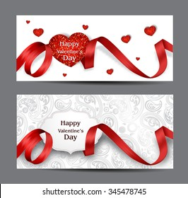 Beautiful Valentine's Day cards with red silk ribbons and textured hearts