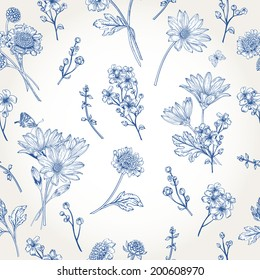 Beautiful vintage seamless pattern with blue flowers on a white background. Garden asters, chrysanthemums, daisies. Vector illustration.