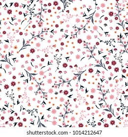 Beautiful wild flowers bright pattern in small-scale pink and red flowers. Liberty style meadow. Floral seamless background for textile, book covers,  wallpapers, print, gift wrap and scrapbook