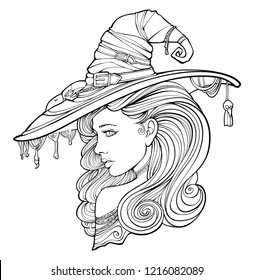 Beautiful witch in a hat