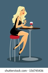 beautiful woman is drinking wine at the bar