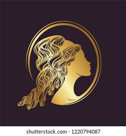 Beautiful woman portrait with elegant curly hairstyle in metallic gold color.Greek goddess cameo illustration.Beauty, style and hair salon logo isolated on dark background.
