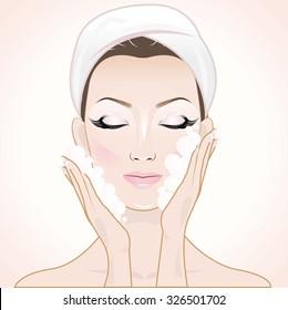 Beautiful woman in process of washing face