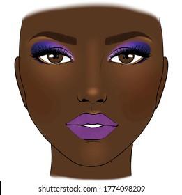 Beautiful woman with purple lipstick blue glitter eye shadow and blush brown skin foundation