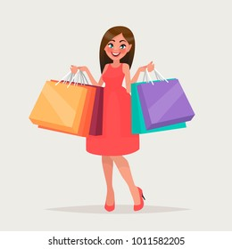 Beautiful woman is shopping. The girl with the packages. Fashionable. Vector illustration in cartoon style