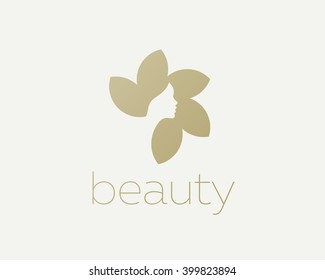 Beautiful woman's face flower star logo design template.  Hair, girl, sun negative space logotype. Abstract design concept for beauty salon, massage, magazine, cosmetic and spa. Premium vector icon.