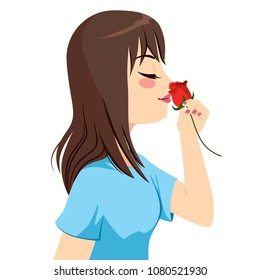 Beautiful young brunette woman holding red rose flower in front of nose smelling scent