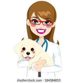 Beautiful young female veterinarian hugging cute little Labrador puppy