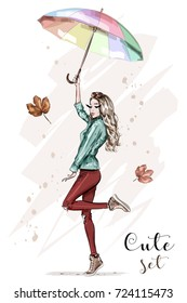 Beautiful young woman with colorful umbrella. Stylish hand drawn girl in fashion clothes. Fashion woman. Sketch. Vector illustration.