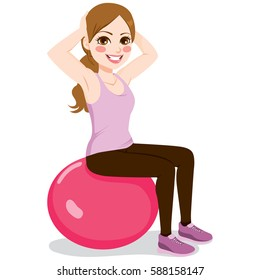 Beautiful young woman exercising with fitness yoga ball