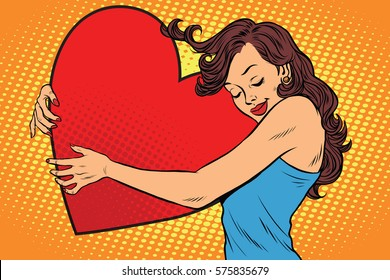 Beautiful young woman hugging Valentine heart