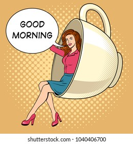 Beautiful young woman sit in coffee cup pop art retro vector illustration. Text bubble. Comic book style imitation.