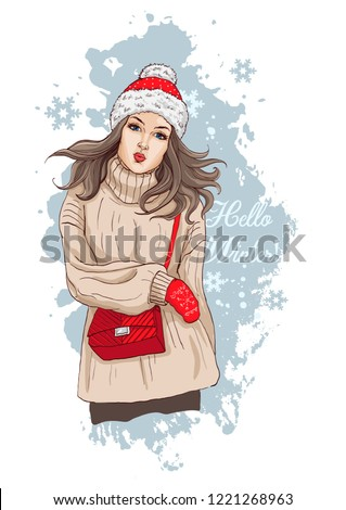 00322cb413 Beautiful young woman in stylish clothes. The girl has Christmas  accessories  hat