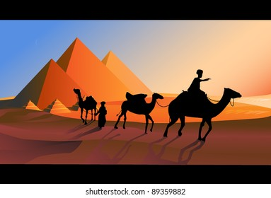 Bedouin caravan camels against over pyramids.