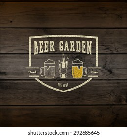 Beer garden badges logos and labels for any use, logo templates and design elements for beer house, bar, pub, brewing company, brewery, tavern, restaurant, on wooden background texture