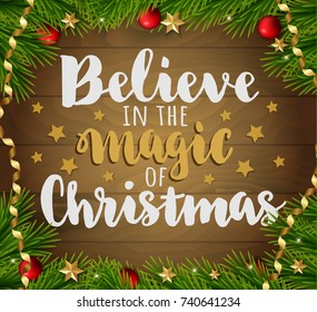 Believe in the magic of christmas. Vector greeting christmas card with decorations on wood background