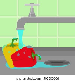 Bell peppers being cleaned and washed in a sink in a kitchen. Running tap water.