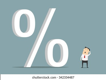 Bemused businessman looking up at big percent symbol, for high cost credit or rising interest rate