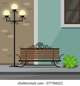 Bench and Street Light on Roadside with Flower Pot and Buildings Background.