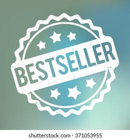 Bestseller rubber stamp white on a blue bokeh fog background.