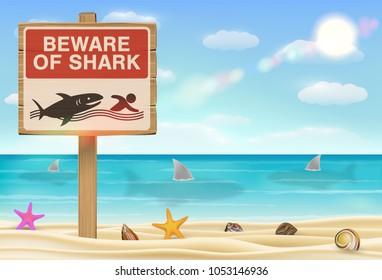 beware of shark sign on sea sand beach