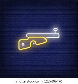 Biathlon gun neon sign. Glowing neon gun on dark blue brick background. Can be used for topics like hunting, biathlon, winter sport