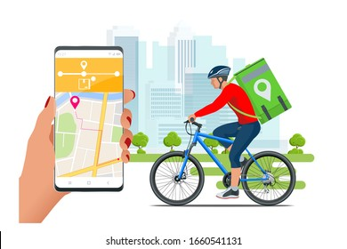 Bicycle courier, Express delivery service. Courier on bicycle with parcel box on the back delivering food In city. Ecological fast delivery. City Food delivery service. Online ordering.