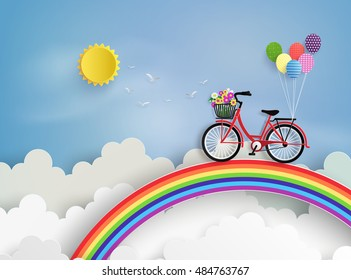 Bicycle riding on a rainbow with blue sky.paper at style.
