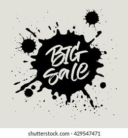 Big Sale handwritten inscription. Modern brush calligraphy on black ink splatter background. Handwritten lettering for sale tag, special offer banner or poster design.