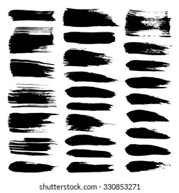 Big set of abstract  black textured strokes of dry paint on white background