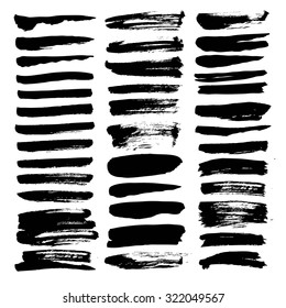 Big set of thin smears of  black ink isolated on a white background
