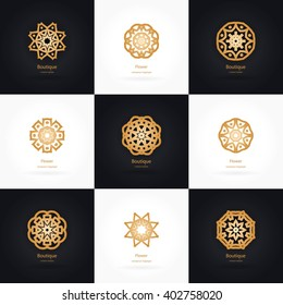 Big set of vintage gold logo. Luxury logotype in the shape of a flower for antique boutique. Simple geometric icons, business, invitations. Volumetric golden big bud. Vintage. Islam, Arabic, Indian.