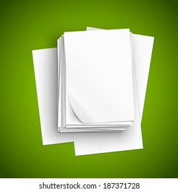 Big stack of white paper sheets and scattered pages on green table