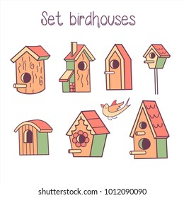 Big vector set of birdhouses. Spring clipart. The bird flies to the birdhouse. Isolated on a white background.