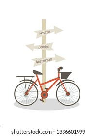 Bike is Parked at Post with Direction Signs. Flat Vector Illustration on White Background Post with Pointers to Moscow London Amsterdam. Red City Bike With Black Basket in Front and Rear Trunk.